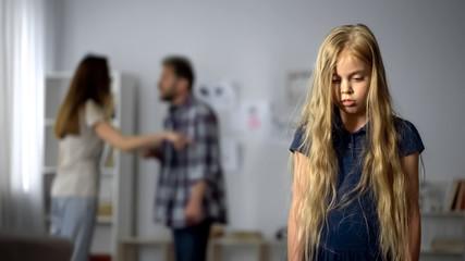 Girl listening parents quarreling, childhood trauma, mental abuse, hotline