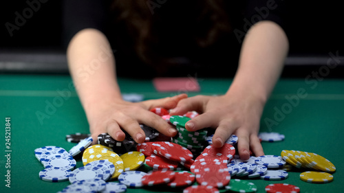 Canvas Female poker player betting all casino chips, believe in success, risky strategy