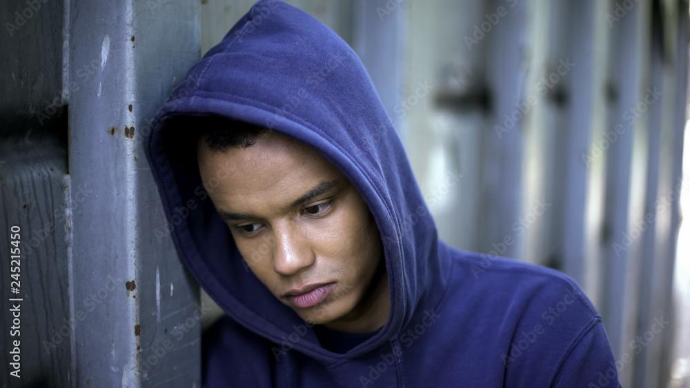 Fototapeta Mixed-race guy suffering from bullying, racial discrimination, cruel youth