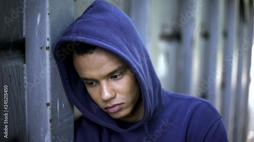 Obraz Mixed-race guy suffering from bullying, racial discrimination, cruel youth - fototapety do salonu