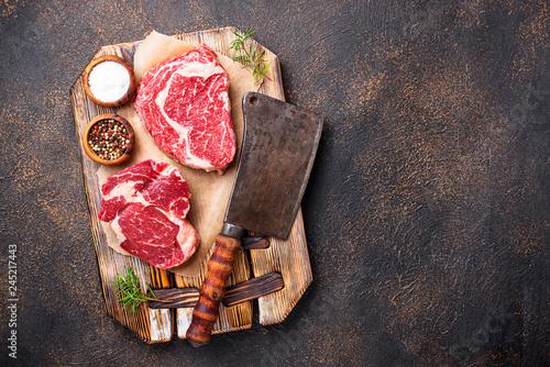Fotografie, Obraz  Raw marbled ribeye steak and butchers knife