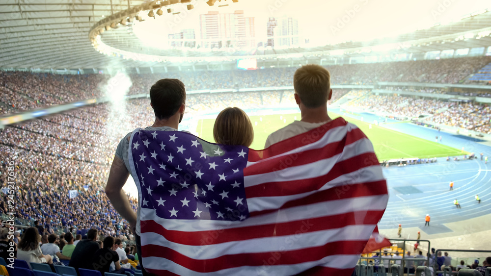 Fototapety, obrazy: Football fans with American flag jumping at stadium, cheering for national team