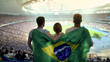 canvas print picture - Football fans with Brazilian flag jumping at stadium, cheering for national team