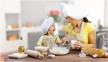 Portrait Of Adorable Little Girl And Her Mother Cooking Together