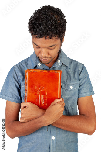 Fotografia  Young Indo-Mauritian or Creole Pastor in training holding a bible lovingly