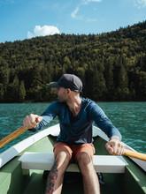 Man Looking Away While Rowing ...