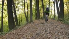 Man Riding Montain Bike Uphill...