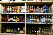 Defocused picture of shelves with multi-colored bottles of wine