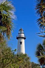 White Brick Lighthouse Through Trees