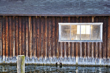 Old Wooden Boathouse With Window.