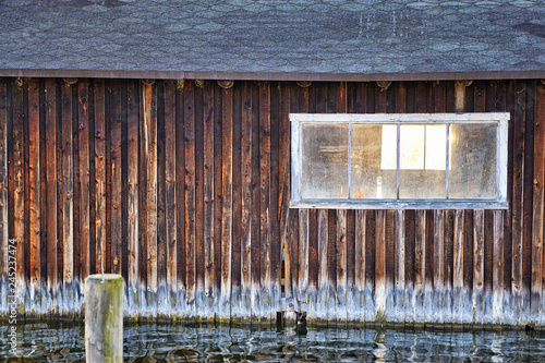 Old wooden boathouse with window. Fototapete
