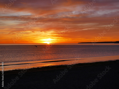 Fotografia  Red sunrise on the Atlantic Ocean