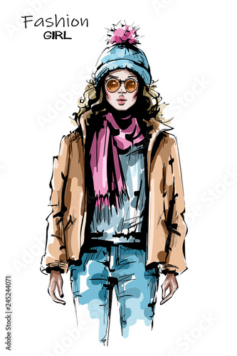 f8b90e3f62 Hand drawn beautiful young woman in sunglasses. Stylish girl in winter  clothes. Fashion woman look. Sketch.