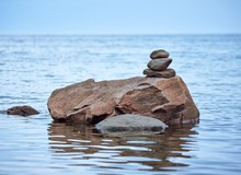 Stones Stacked On Top Of A Big...