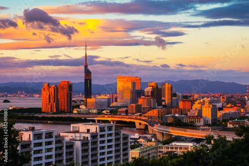 Deurstickers Asia land A sunset with a view of central Fukuoka, Japan, with tall modern buildings