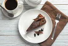 Slice Of Tasty Chocolate Cake And Cup Of Coffee Served On Wooden Table, Top View