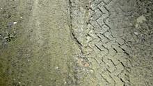 Tracks In Muddy Sand Road - 2997FPS NTSC