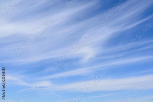 Cirrus clouds on blue sky, thin and wispy Fototapeta