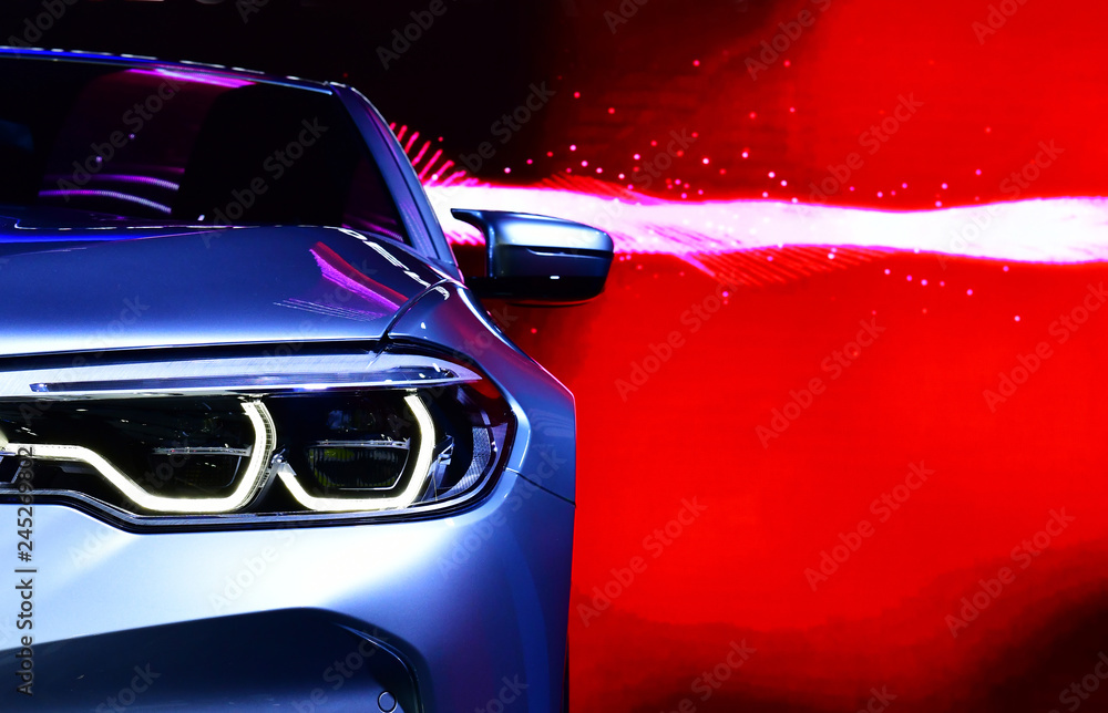 Fototapety, obrazy: Detail on one of the LED headlights modern car on red background