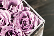 Pastel Purple Hued Roses In Clear Acrylic Crystal Flower Box. Square Glass Gift Box. Overhead, Copyspace