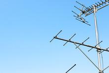 Antennastandingwithskybackground