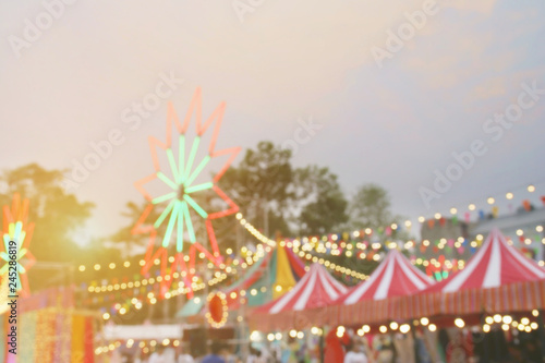 Blurred Background Image of Weekend Market Festival with Colorful Light Decorations