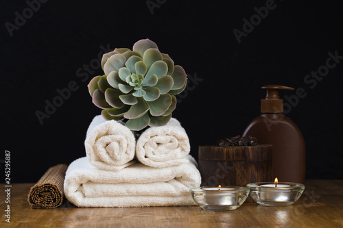 Foto op Plexiglas Spa Spa still life with aromatic candles, flower and towel. - Image.