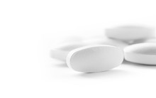 White Medicine Tablets In Selective Focus