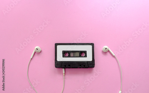 Fotografie, Obraz  Vintage Retro Black Cassette Mix Tape and ear phone on Pink Background