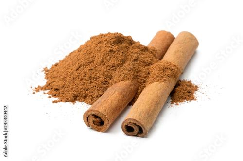 Valokuvatapetti Heap of ground cinnamon and cassia cinnamon sticks