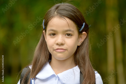Fotografija  Serious Cute Filipina Child Girl Student With Notebooks