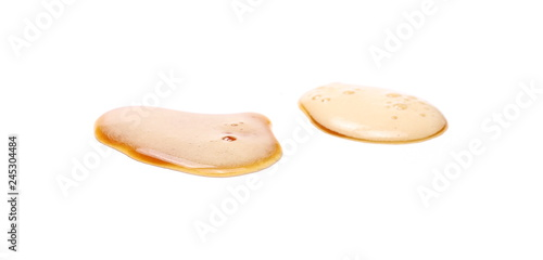 Spoed Foto op Canvas Bier / Cider Spilled beer puddle with foam isolated on white background and texture