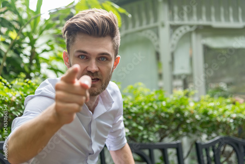 Fotografie, Obraz  Young furious caucasian businessman shouting and pointing camera