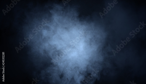 Blue fog and misty effect on black background. Smoke texture overlays - 245312281