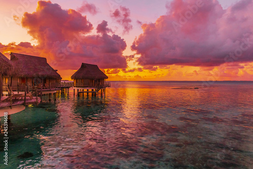 Türaufkleber Rotglühen Coastline with a tropical beach and the turquoise water of the inner lagoon of the atoll of Tikehau at Sunset. Tuamotus archipelago, French Polynesia, south Pacific ocean.