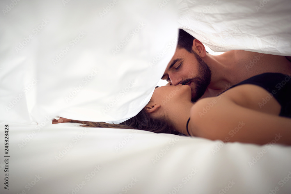 Fototapety, obrazy: man and woman making love in bedroom.