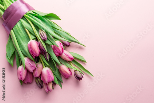 Photo  Bouquet pink tulips on lightpink background.