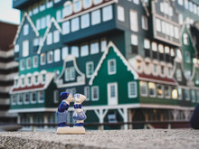 Traditional Dutch Holiday Gift On A Blurred Background Of The Famous Hotel In Zaandam
