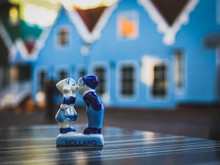 Zaandam The Netherlands, A Famous Tourist Spot On The Street With Blue Houses In The Evening With A Traditional Dutch Souvenir, A Kiss For A Boy And A Girl