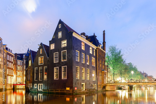 Photo  Beautiful houses by the canals in Amsterdam, Holland