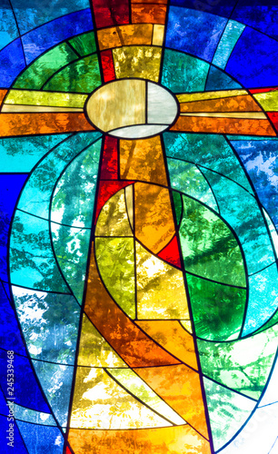 Valokuva  Stained glass cross in bright vivid colors