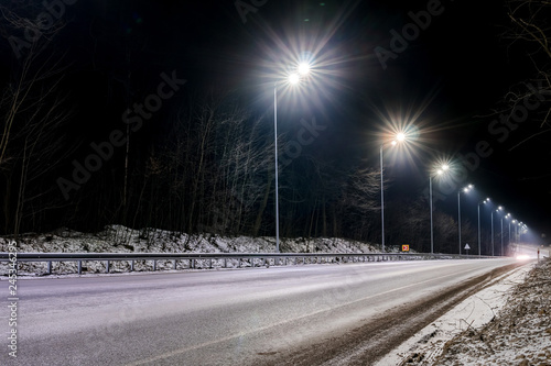Fototapeta street lighting, supports for ceilings with led lamps. concept of modernization and maintenance of lamps, place for text, night. winter season. energy-saving lamps, safety of movement obraz na płótnie
