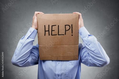 Cardboard box on businessman head ask for help Fototapet