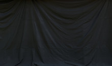 Background Image Of Black Canvas Curtain Hanging With Wrinkles