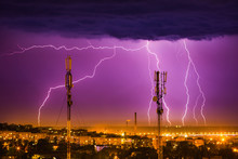 Storm Lightning On The Horizon Over Telephone Towers