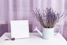 Lavender Flowers In Watering C...