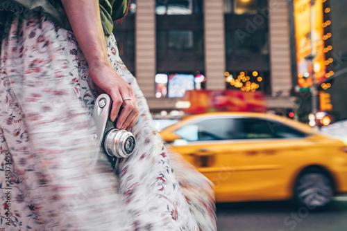 Poster New York City Female hand with a retro camera close-up