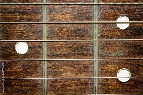 Spoed Foto op Canvas Muziekwinkel Fragment of an acoustic guitar - closeup shot