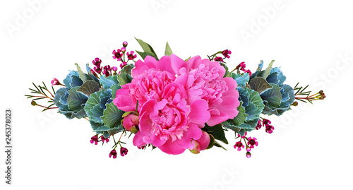 Ornamental kales and pink peony flowers in a floral line arrangement