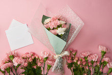 Top View Of Beautiful Bouquet, Tender Pink Flowers And White Envelope With Card Isolated On Pink
